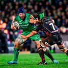 Connacht's John Muldoon is tackled by Newport Gwent Dragons' Nic Cudd. Photo by Ramsey Cardy/Sportsfile
