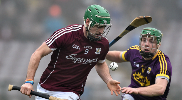 David Burke of Galway in action against Aidan Nolan of Wexford Photo by David Maher/Sportsfile