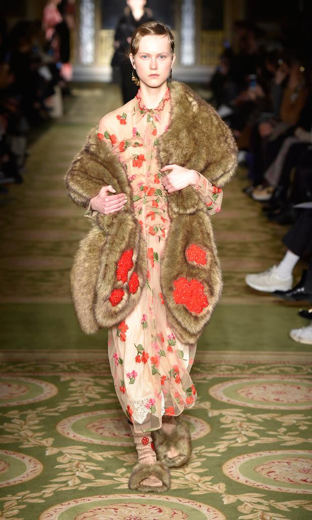Models take to the catwalk for Simone Rocha's 'Marching Roses' AW17 collection at London Fashion Week