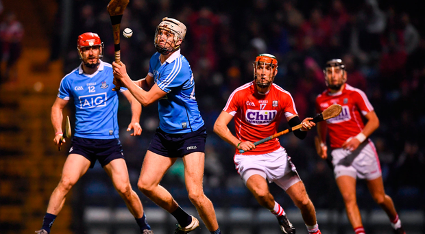Dublin's Eoin Conroy strikes his side's second goal during Saturday's Division 1A Round 2 win over Cork at Páirc Uí Rinn (Picture: Sportsfile)