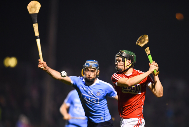 Mark Coleman of Cork in action against Rian McBride of Dublin Photo by Stephen McCarthy/Sportsfile