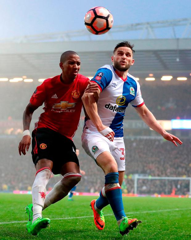 Manchester United's Ashley Young and Blackburn Rovers' Craig Conway. Photo: Martin Rickett/PA Wire