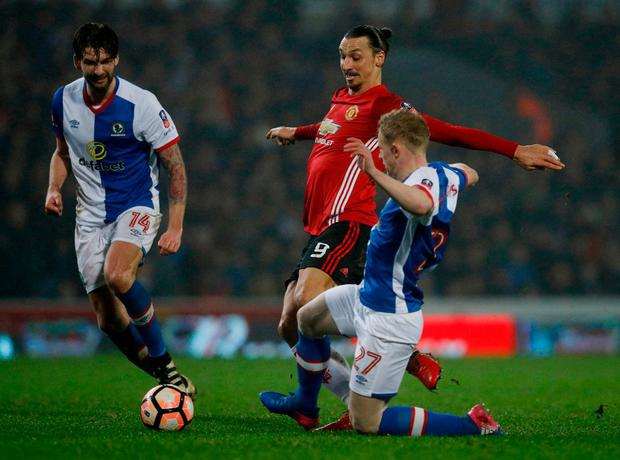 Manchester United's Zlatan Ibrahimovic in action with Blackburn Rovers' Willem Tomlinson. Photo: Phil Noble/Reuters