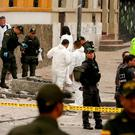 Police and investigators inspect the site where a homemade bomb exploded near the Santamaria bull ring in Bogota, Colombia. Photo: Ricardo Mazalan/AP Photo