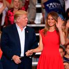 President Donald Trump and Melania Trump stand together during a campaign rally at the AeroMod International hangar at Orlando Melbourne International Airport on February 18, 2017 in Melbourne, Florida. President Trump is holding his rally as he continues to try to push his agenda through in Washington, DC. (Photo by Joe Raedle/Getty Images)