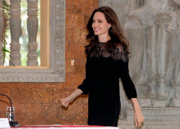 Hollywood actress Angelina Jolie arrives for a press conference in Siem Reap province, Cambodia, Saturday, Feb. 18, 2017.