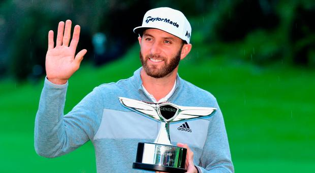 Dustin Johnson poses with the trophy during the final round at the Genesis Open at Riviera Country Club in Pacific Palisades, California. (Photo by Harry How/Getty Images)