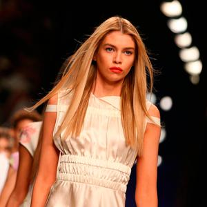 Stella Maxwell presents creations by TOPSHOP UNIQUE during a catwalk show on the third day of the Autumn/Winter 2017 London Fashion Week