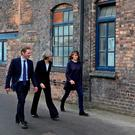 Prime Minister Theresa May (centre) and Stoke Central by-election candidate Jack Brereton with Emma Bridgewater during a tour of the Emma Bridgewater pottery factory in Hanley, Stoke-On-Trent Credit: Christopher Furlong/PA Wire