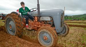 Ger Cummins (16) from Cork pictured taking part in his first ploughing competion in the Confined vintage class at the annual ploughing match at Clogagh, Co Cork. Photo: Denis Boyle