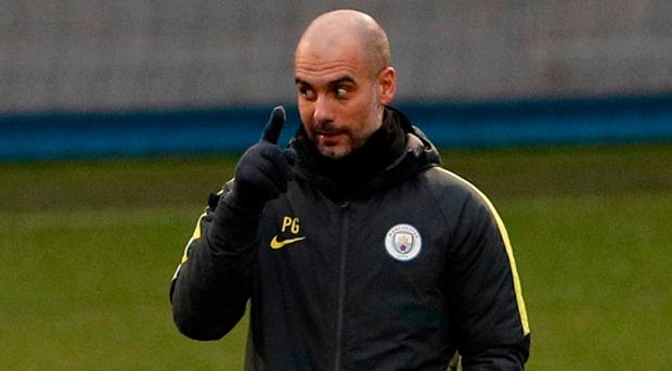 Pep Guardiola has a word with his players during training ahead of tonight's game against Monaco. Photo: Lee Smith/Action Images via Reuters