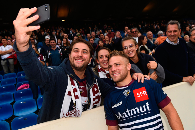 Posing for a selfie with a supporter Photo: Ramsey Cardy/Sportsfile