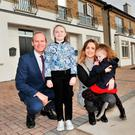 Housing Minister Simon Coveney with Jenna Foley and daughters Chloe (8) and Kaylee (5) as they show him their new home at Sheridan Park in Togher, Cork, yesterday. Jenna Foley has been on the housing waiting list for nine years. She will be the first resident of Sheridan Park later this week. Ms Foley said: 'It's a dream come true – it's a gorgeous house, but best of all it will be our home.' Photo: Daragh McSweeney