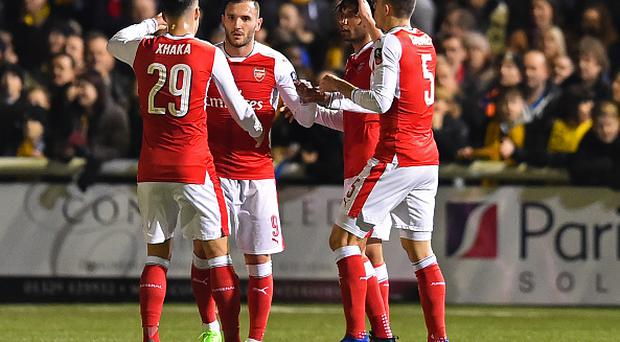 Arsenal's Spanish striker Lucas Perez (2nd L) celebrates with teammates after scoring the opening goal of the English FA Cup fifth round football match between Sutton United and Arsenal at the Borough Sports Ground, Gander Green Lane in south London on February 20, 2017.