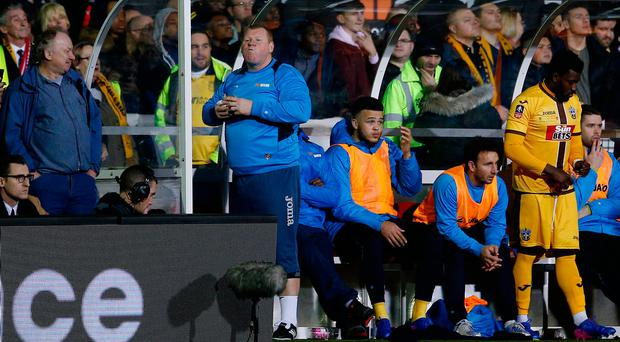 Sutton United's substitute goalkeeper and goalkeeping coach Wayne Shaw eats a pie during last night's FA Cup last 16 tie against Arsenal Photo: Reuters / Andrew Couldridge