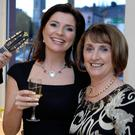 Marian O'Gorman, founder of The Kilkenny Group, with TV3's Collette Fitzpatrick at the Kilkenny Shop's first birthday in Cork. Photo: Don MacMonagle