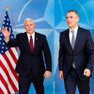 US Vice-President Mike Pence waves next to Nato Secretary General Jens Stoltenberg at the Alliance headquarters in Brussels Photo: REUTERS/Virginia Mayo/Pool