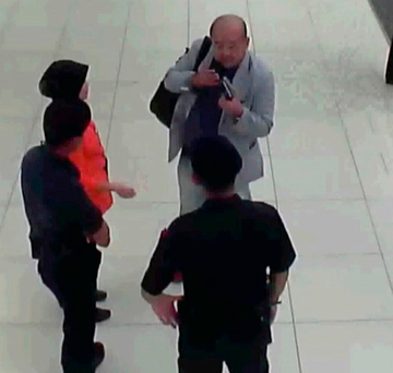 CCTV footage of Kim Jong Nam with airport security and officials after he was attacked at Kuala Lumpur Airport Photo: Fuji Television via AP