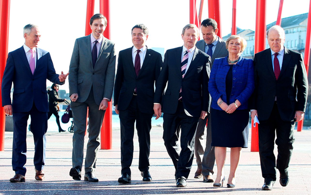 Enda Kenny (centre) with Richard Bruton, Simon Harris, Paschal Donohoe, Leo Varadkar, Frances Fitzgerald and Michael Noonan at an election news conference. Photo: Tom Burke