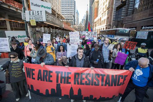 People march during a protest Monday, Feb. 20, 2017, in Philadelphia. Thousands of demonstrators turned out Monday across the U.S. to challenge Donald Trump in a Presidents Day protest dubbed Not My President's Day. (Michael Bryant/The Philadelphia Inquirer via AP)