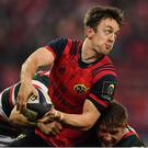 10 December 2016; Darren Sweetnam of Munster is tackled by Adam Thompstone, left, and Tom Youngs of Leicester Tigers during the European Rugby Champions Cup Pool 1 Round 3 match between Munster and Leicester Tigers at Thomond Park in Limerick. Photo by Brendan Moran/Sportsfile
