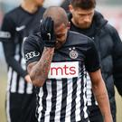 Partizan Belgrade's Brazilian midfielder Everton Luiz leaves the field in tears on February 19, 2017, at the end of a Serbian championship match between Partizan and Rad, after racist remarks from Rad's supporters, Serbian television B92 reported. (Photo credit STR/AFP/Getty Images)