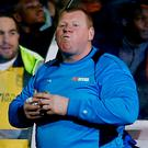 Sutton United's substitute Wayne Shaw eats a pie during the match last night