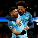 Manchester City's Sergio Aguero celebrates scoring his side's third goal with Leroy Sane