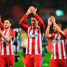 Atletico Madrid's forward Fernando Torres (C) and his teammates applaud after the UEFA Champions League round of 16 first-leg football match between Bayer 04 Leverkusen and Club Atletico de Madrid in Leverkusen