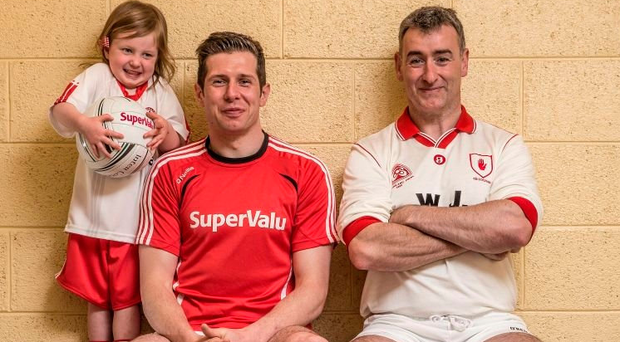 Seán Cavanagh with his daughter Eva and former Tyrone footballer and current Cavan boss Mattie McGlennan in 2015. Picture: INPHO/Billy Stickland