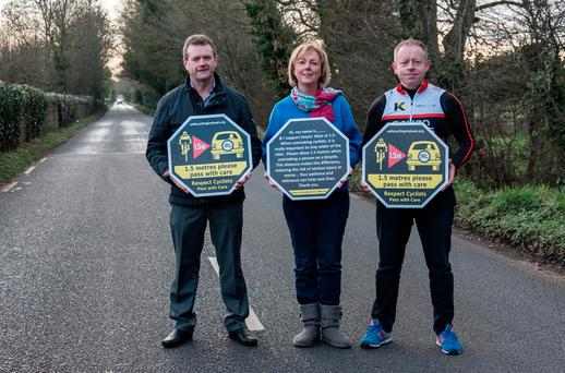 Cyclist Phil Skelton (left) Government chief whip Regina Doherty and TD Ciarán Cannon (right) promote their 1.5 metre bill