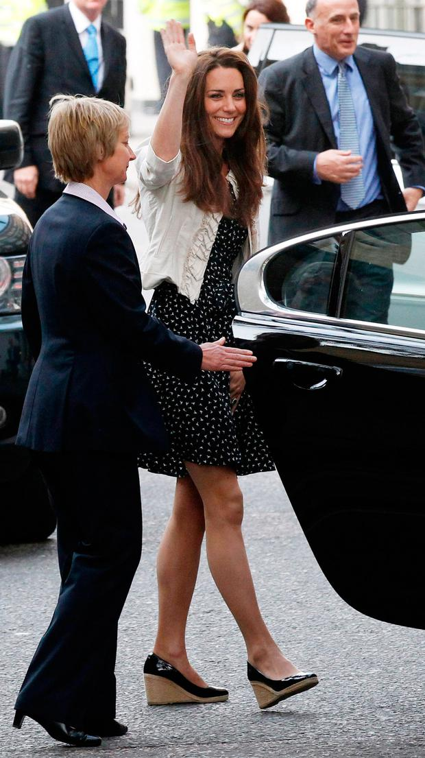 Catherine Middleton waves to the crowds as she arrives at The Goring Hotel after visiting Westminster Abbey on April 28, 2011 in London, England.