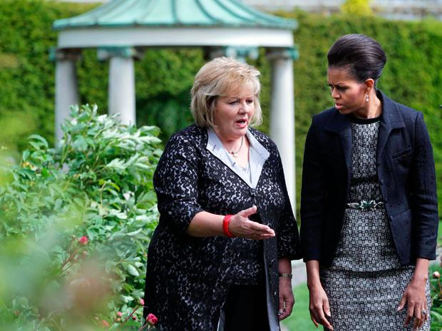 Fionnuala Kenny (L), the Taoiseach Enda Kenny's wife, and lady Michelle Obama walk in the garden at Farmeligh May 23, 2011