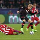 LEVERKUSEN, GERMANY - FEBRUARY 21: Julian Brandt (C) of Bayer Leverkusen in action against Koke (L) of Atletico Madrid during the UEFA Champions League round of sixteen soccer match between Bayer 04 Leverkusen and Atletico Madrid at the BayArena in Leverkusen, Germany on February 21, 2017.