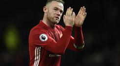 Manchester United's English striker Wayne Rooney applauds the fans following the English Premier League football match between Manchester United and Hull City at Old Trafford in Manchester, north west England, on February 1, 2017. The match ended in a draw at 0-0. / AFP / Oli SCARFF