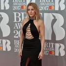 British singer-songwriter Ellie Goulding poses on the red carpet arriving for the BRIT Awards 2017 in London on February 22, 2017. (Photo credit NIKLAS HALLE'N/AFP/Getty Images)