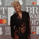 British singer-songwriter Emeli Sande poses on the red carpet arriving for the BRIT Awards 2017 in London on February 22, 2017. / AFP / NIKLAS HALLE'N (Photo credit should read NIKLAS HALLE'N/AFP/Getty Images)
