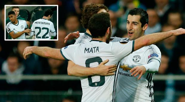 Manchester United's Henrikh Mkhitaryan celebrates scoring their first goal with team mates and (inset) he goes off injured