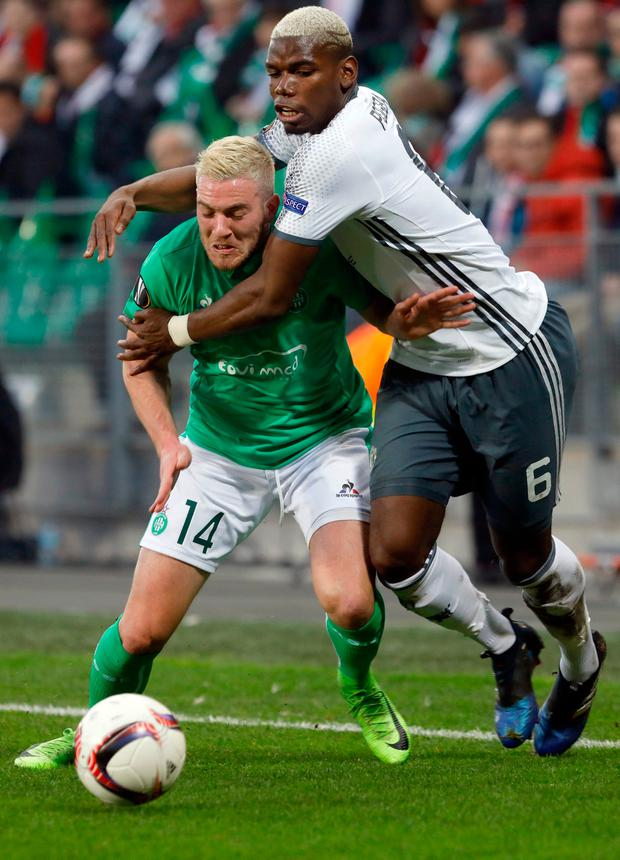 Manchester United's Paul Pogba, right, challenges for the ball with Saint Etienne's Jordan Veretout. Photo: Laurent Cipriani/AP