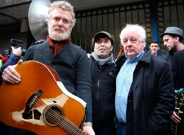 Glen Hansard, Christy Dignam and Jim Sheridan outside Apollo House in Dublin city centre. Photo: Gerry Mooney