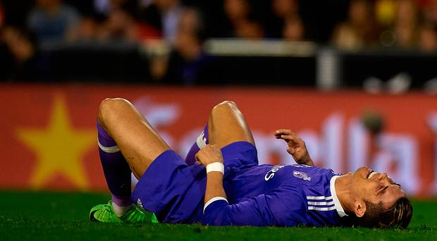 Cristiano Ronaldo reacts after missing a chance during Real Madrid's defeat to Valencia last night interview Picture: Getty