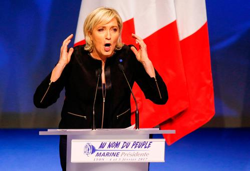 Marine Le Pen, the National Front's candidate in the upcoming French presidential election, speaks at a rally. The poll ratings of the anti-establishment, far-right politician have caused a minor panic in the French government bond market but have not yet spooked the wider economy. Photo: Robert Pratta/Reuters