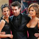 (L-R) Model Kim Bordenave, Colin Farrell and his sister Claudine attend the 75th Annual Academy Awards at the Kodak Theater on March 23, 2003 in Hollywood, California. (Photo by Kevin Winter/Getty Images)