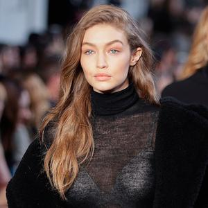 Model Gigi Hadid wears a creation part of the Max Mara women's Fall-Winter 2017-18 collection, that was presented in Milan, Italy, Thursday, Feb. 23, 2017. (AP Photo/Luca Bruno).
