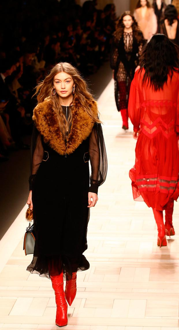 2fc0fe8e93 ... Milan Fashion Week. Model Gigi Hadid presents a creation from the  Fendi s Autumn Winter 2017 women collection during