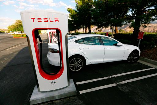 A Tesla Model S charges at a Tesla Supercharger station in Cabazon, California,
