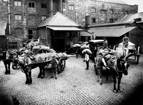 Barley sacks being unloaded at the Old Jameson Distillery, Bow Street, in the 1920s