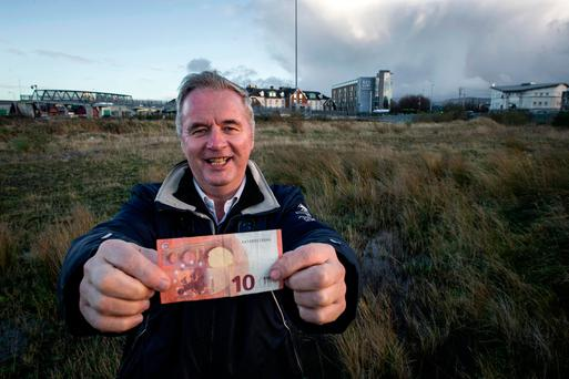 Anthony O'Brien in the field near the Red Cow Roundabout, which is worth hundreds of thousands of euro and which Bluebell United has bought for €10. Photo: Douglas O'Connor