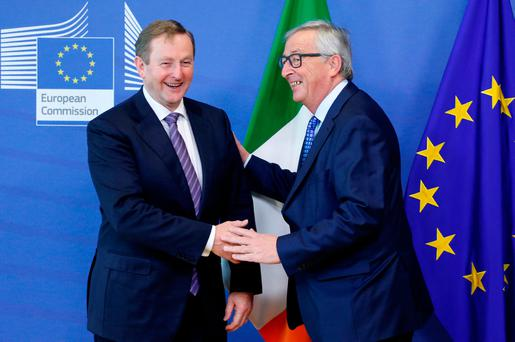 EU President Jean-Claude Juncker greets Taoiseach Enda Kenny ahead of a meeting at the EU Commission headquarters in Brussels yesterday. Photo: Reuters
