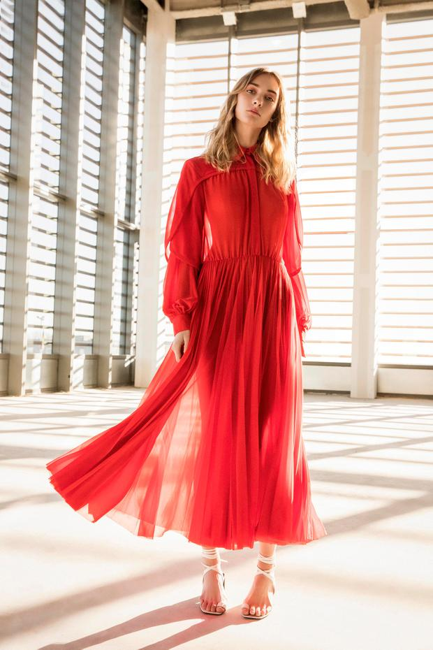 Red sheer shirt dress with pleated skirt €2,550, and white leather lace-up sandals, €580, both by Céline